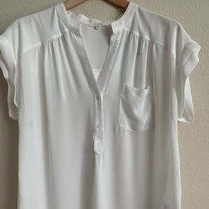 White thin shirt. Great for warmer weather .